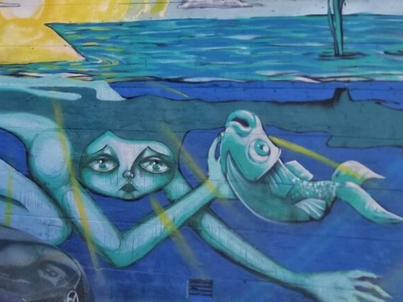 Street art of a mermaid and a fish