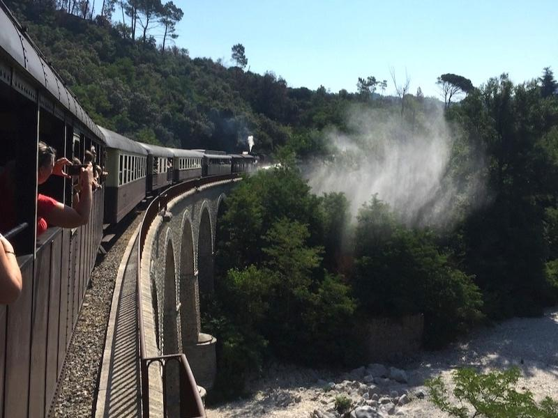 View from a steam train crossing bridge in France