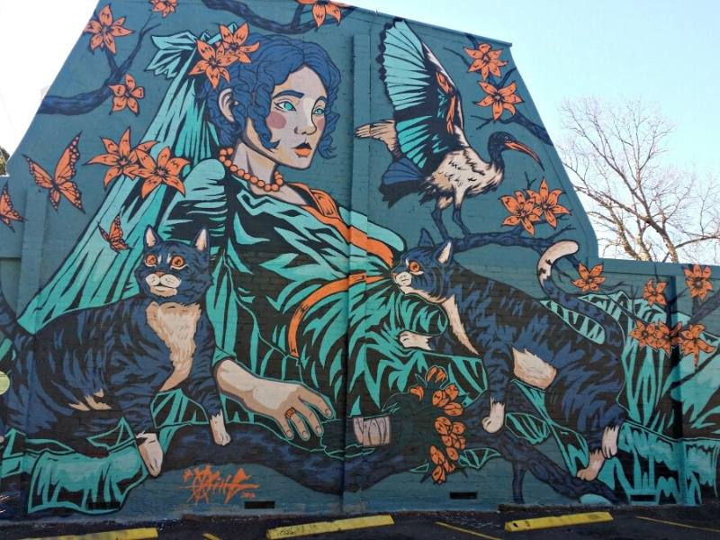 Mural by OxKing of Miss Haversham and her cats in Sydney Australia