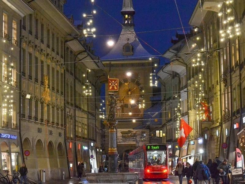 The main street in Bern at christmas lit up with decorations and lights