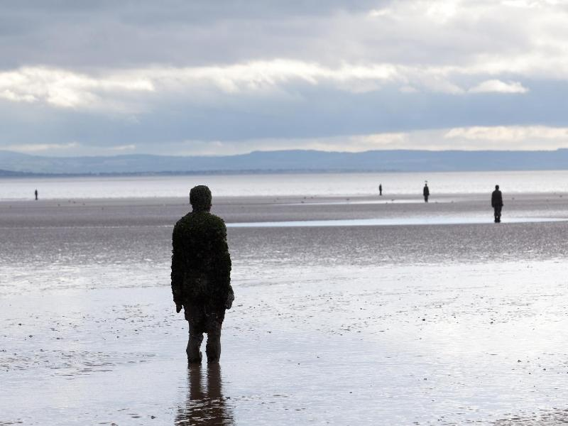 Anthony Gormley's Another Place statue on Crosby Beach in Liverpool