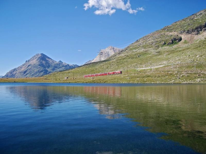Bernina Express by the side of a lake