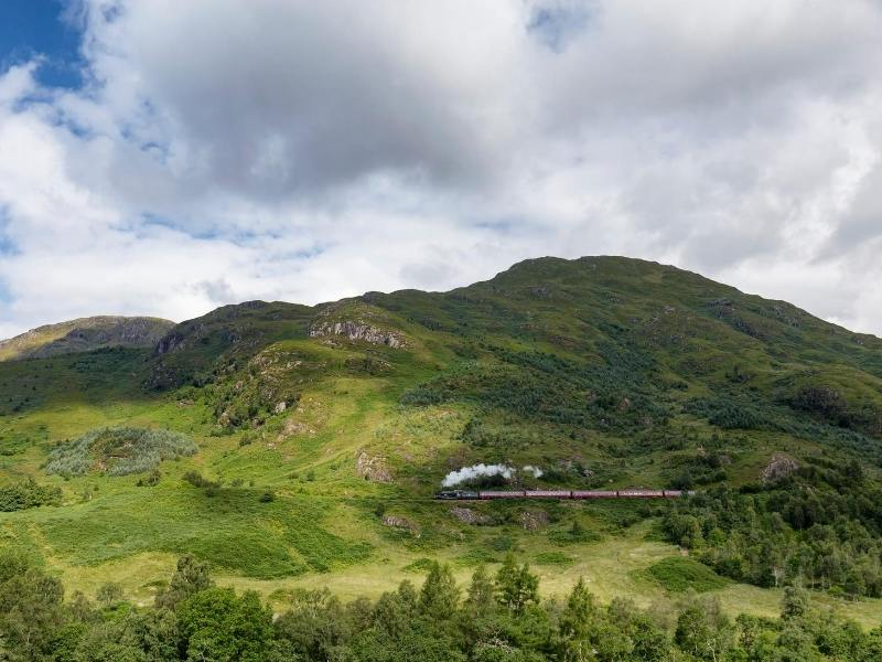 The Jacobite train steaming across the Scottish landscape