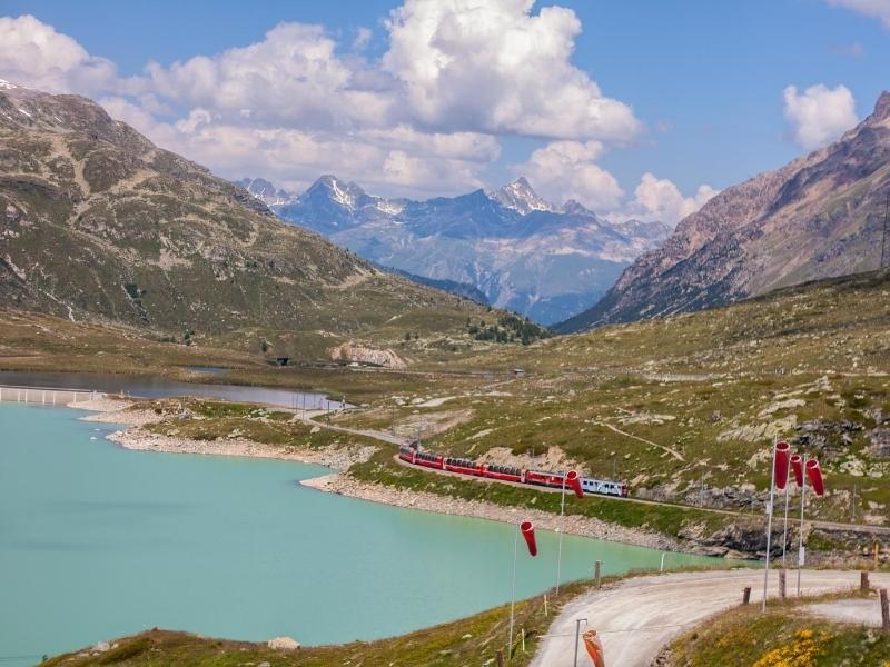 The Bernina Express crosses by Lake Bianco