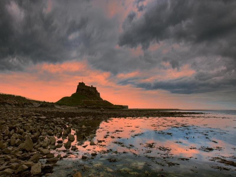The Holy Island of Lindisfarne and Lindisfarne Castle at sunset