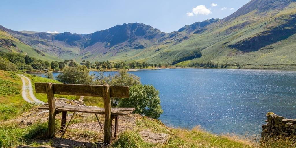 A bench overlooking a lake in the Lake District England