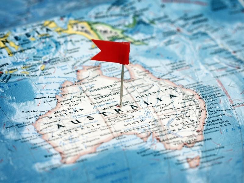 Map of Australia with a red pin flag in it.