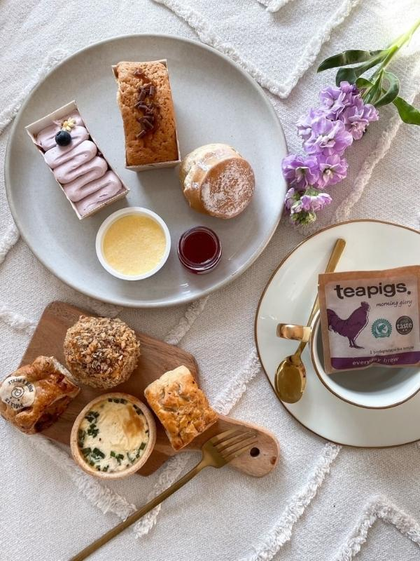 Piglet's Pantry afternoon tea with tea bags, scones and cakes from their afternoon tea in a box range.