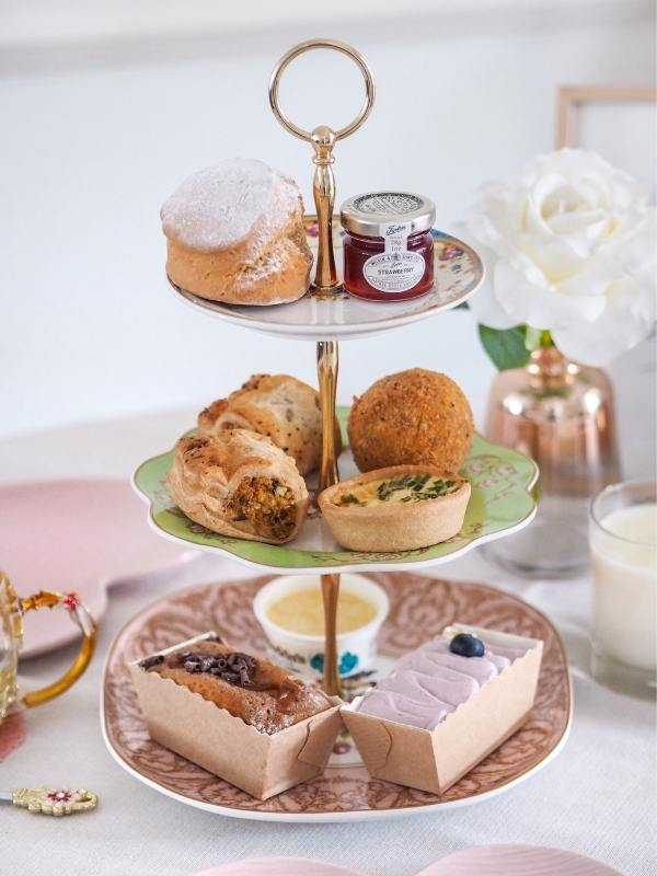 Piglet's Pantry afternoon tea in a box presented beautifully on a stand
