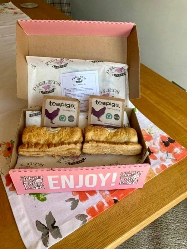 Piglet's Pantry afternoon tea in a box showing sausage rolls and teapigs