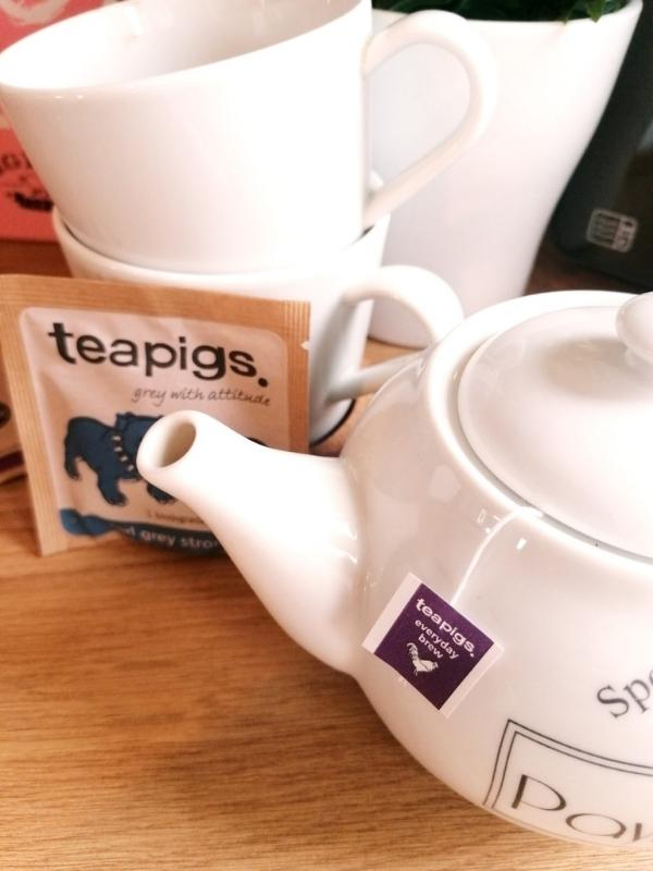 An afternoon tea in a box  by Piglet's Pantry with Piglet's Pantry tea bags and teapot.