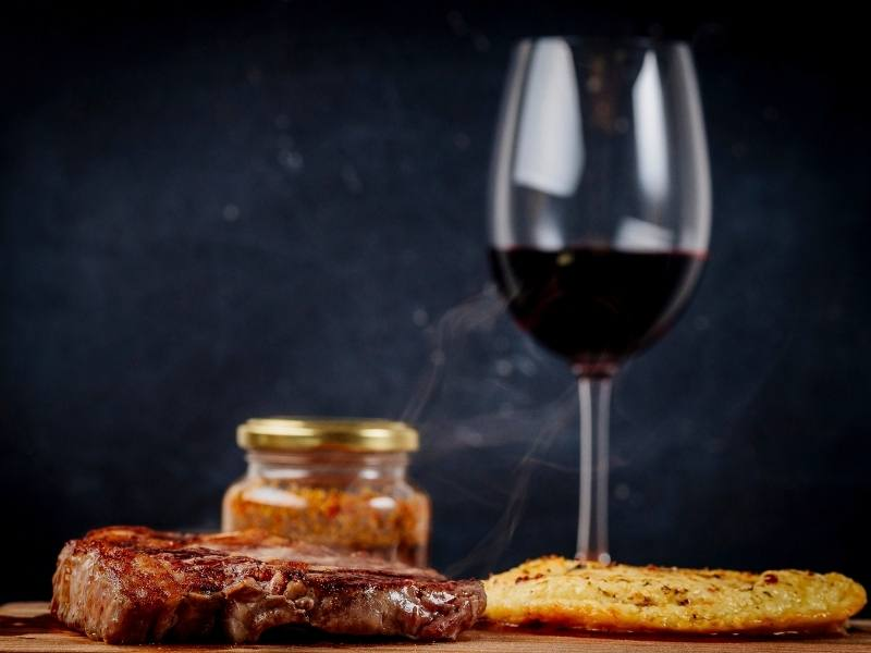 Argentinian steak and glass of red wine.