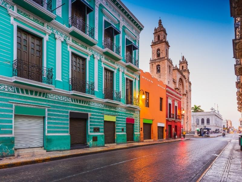 colourful houses in a street in Merida Mexico.