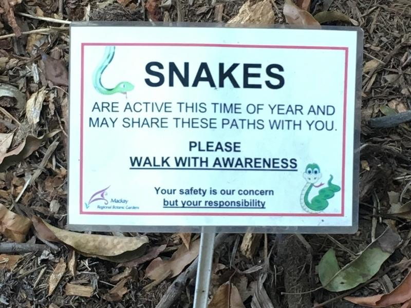 Sign saying watch for snakes.