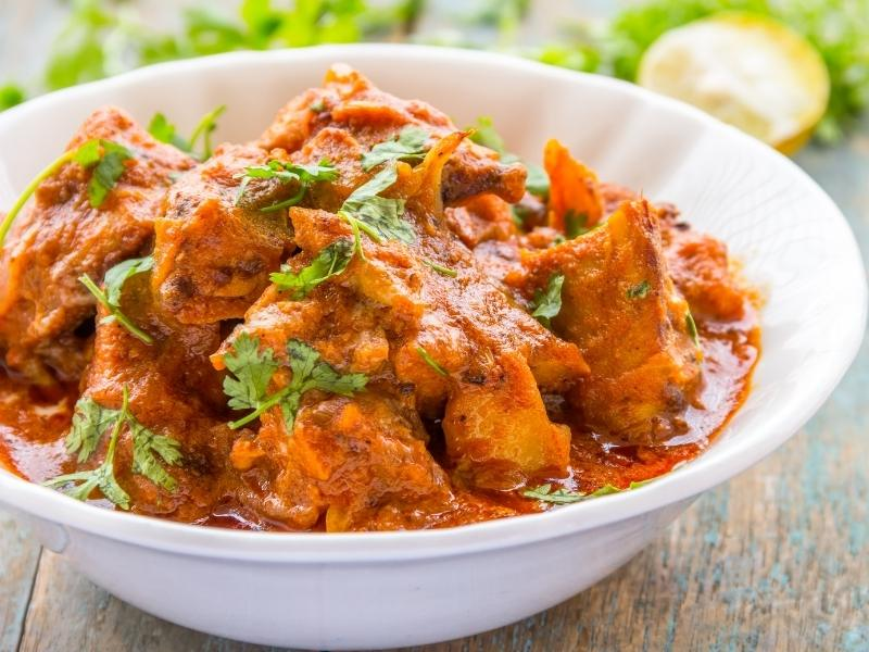 chicken tikka masala in a white dish.